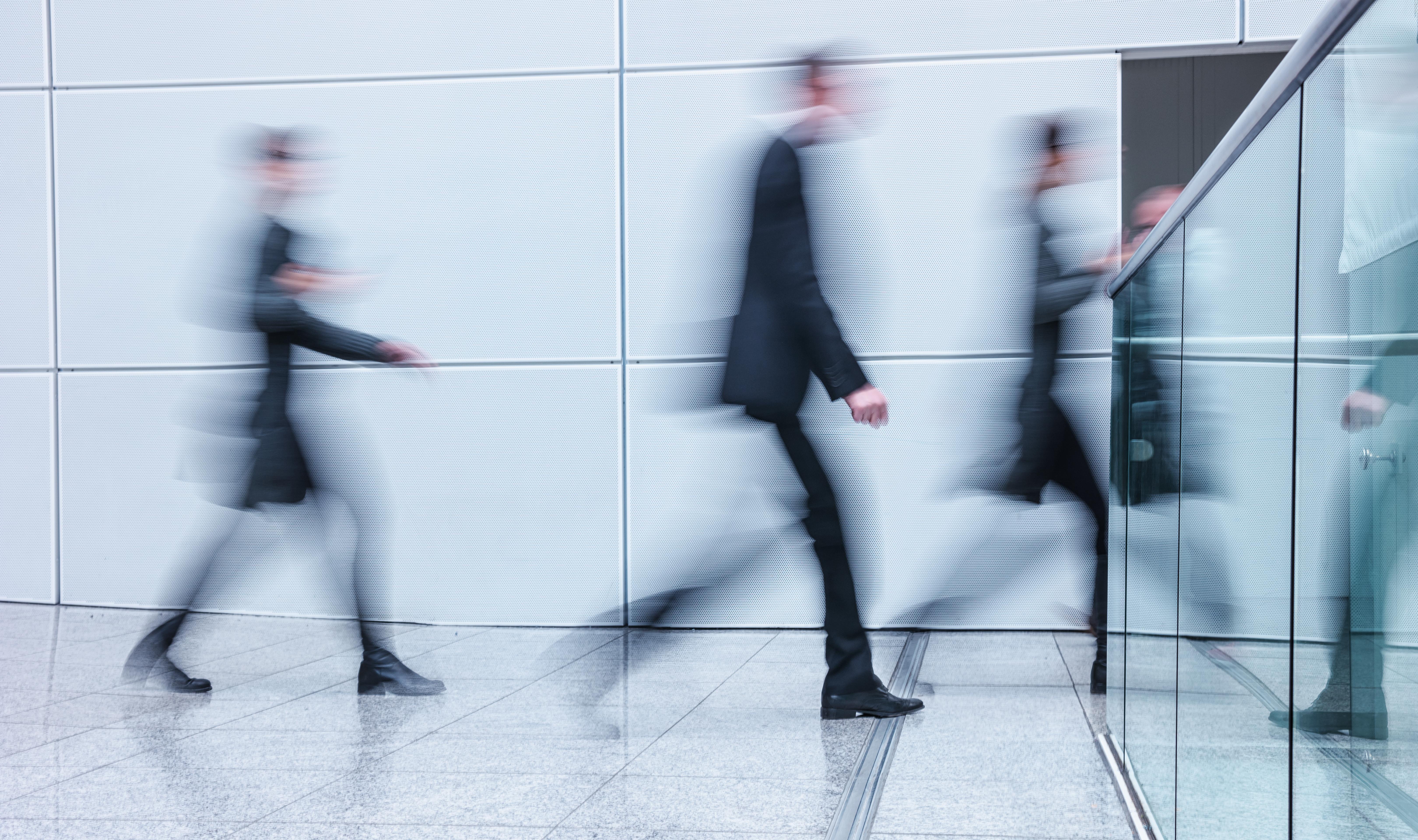 Blurred Motion Of People Walking On Floor In Office
